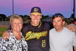 Deb Van Buren is pictured with her husband Scott and their host player, Nate Johnson.