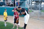 2011 All Star Eduardo Gonzalez signs an autograph for a fan.